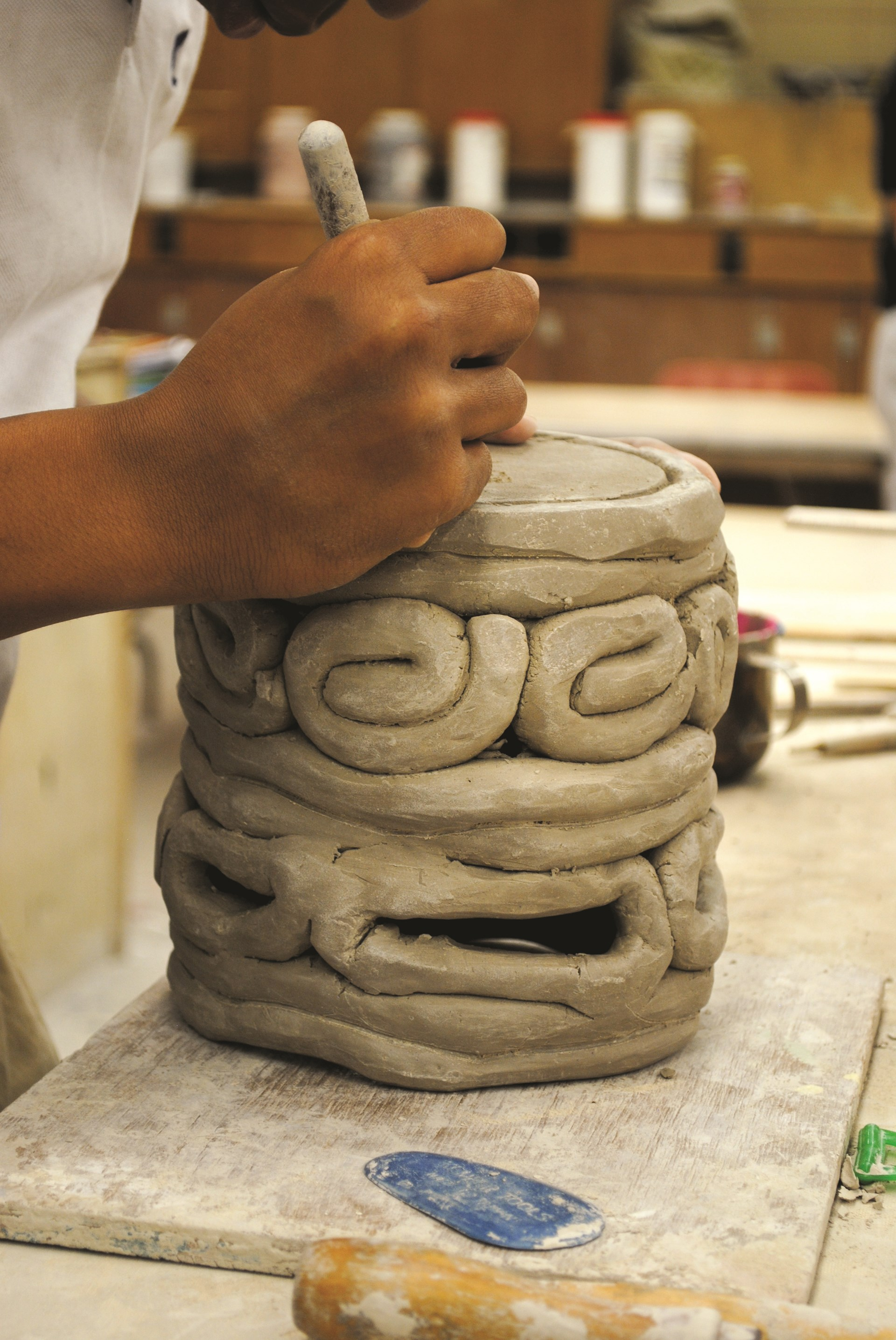 Photo of student working on clay piece