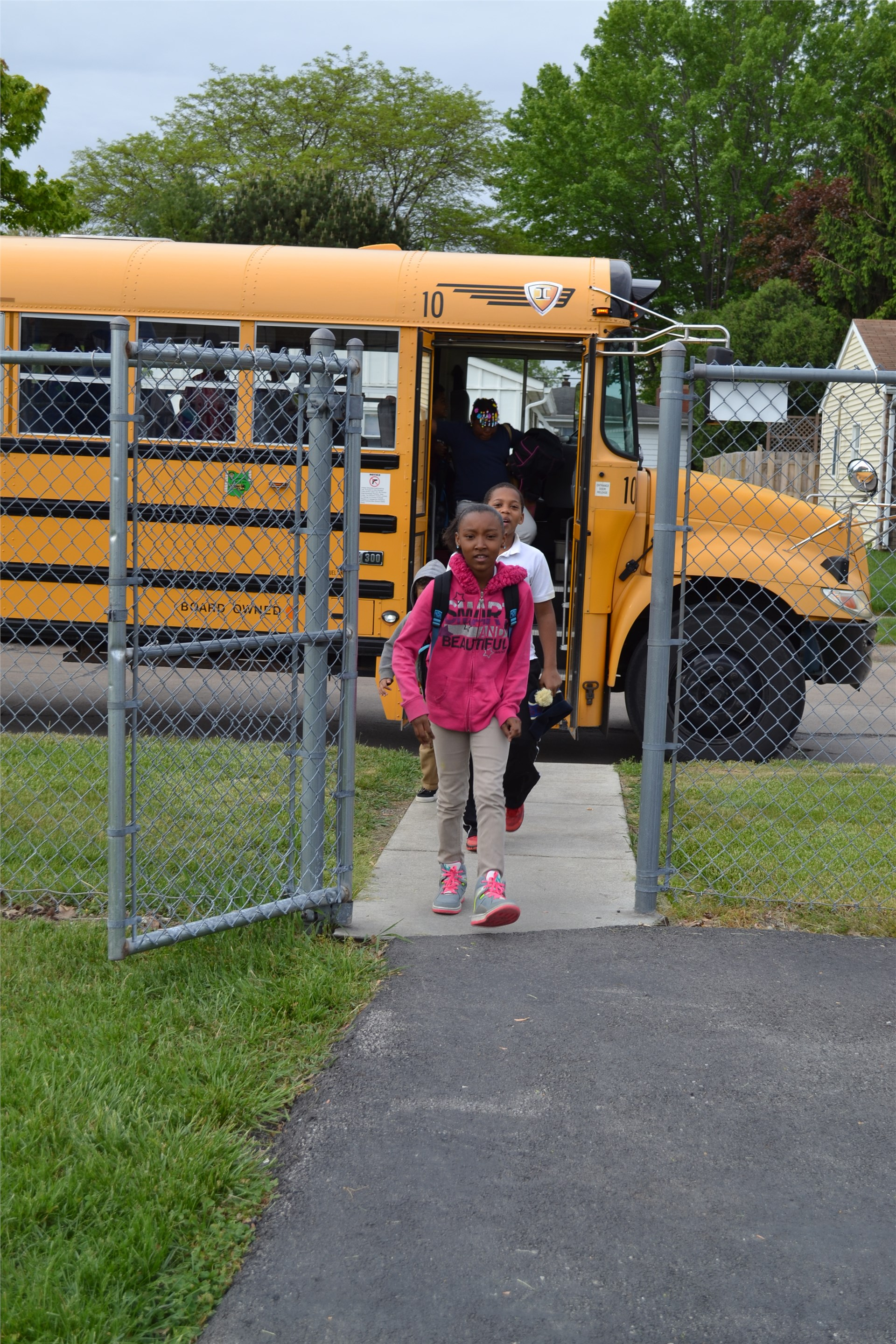 Photo of Students Coming Off of a Bus