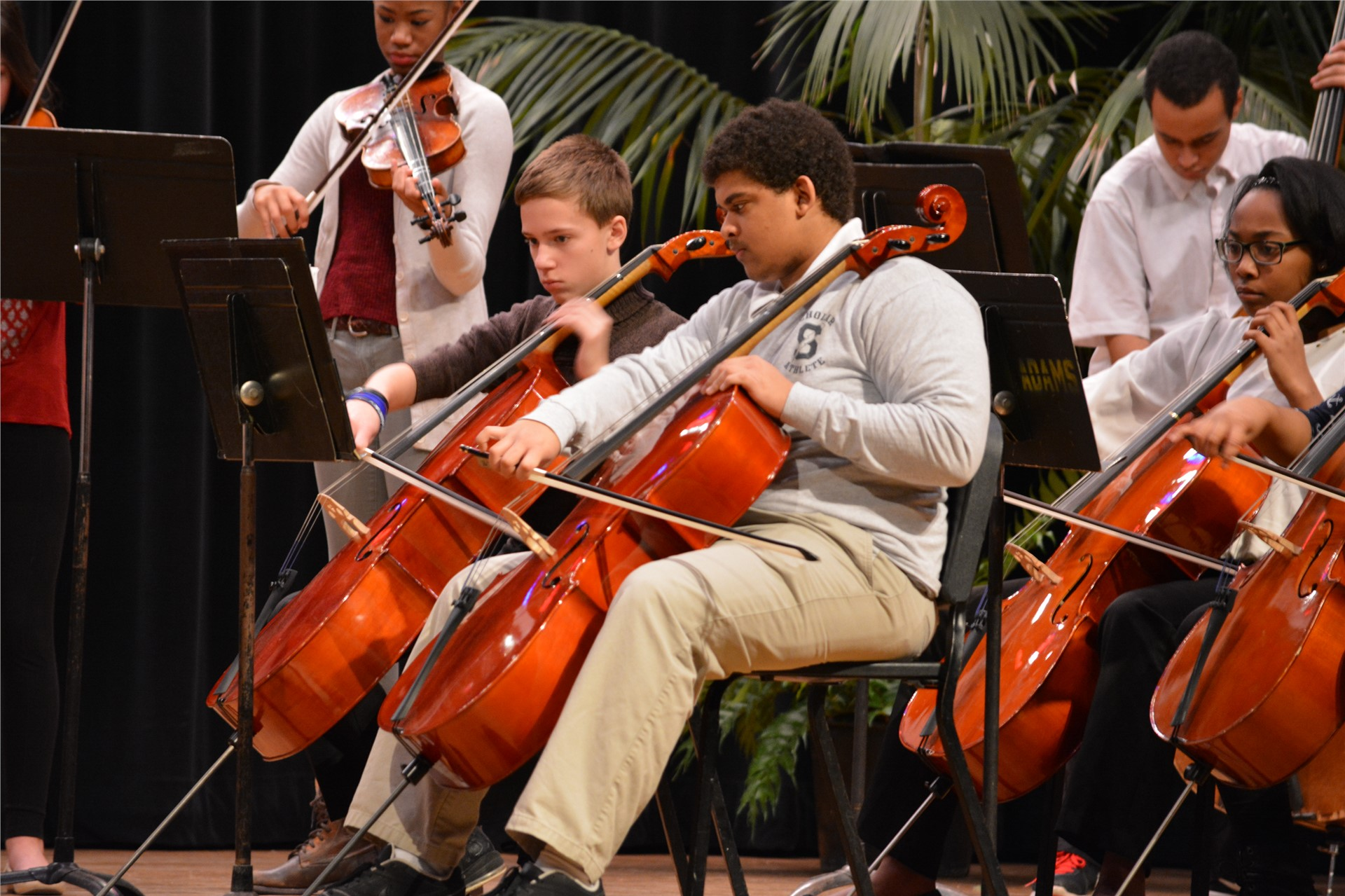 Photo of students playing in orchestra