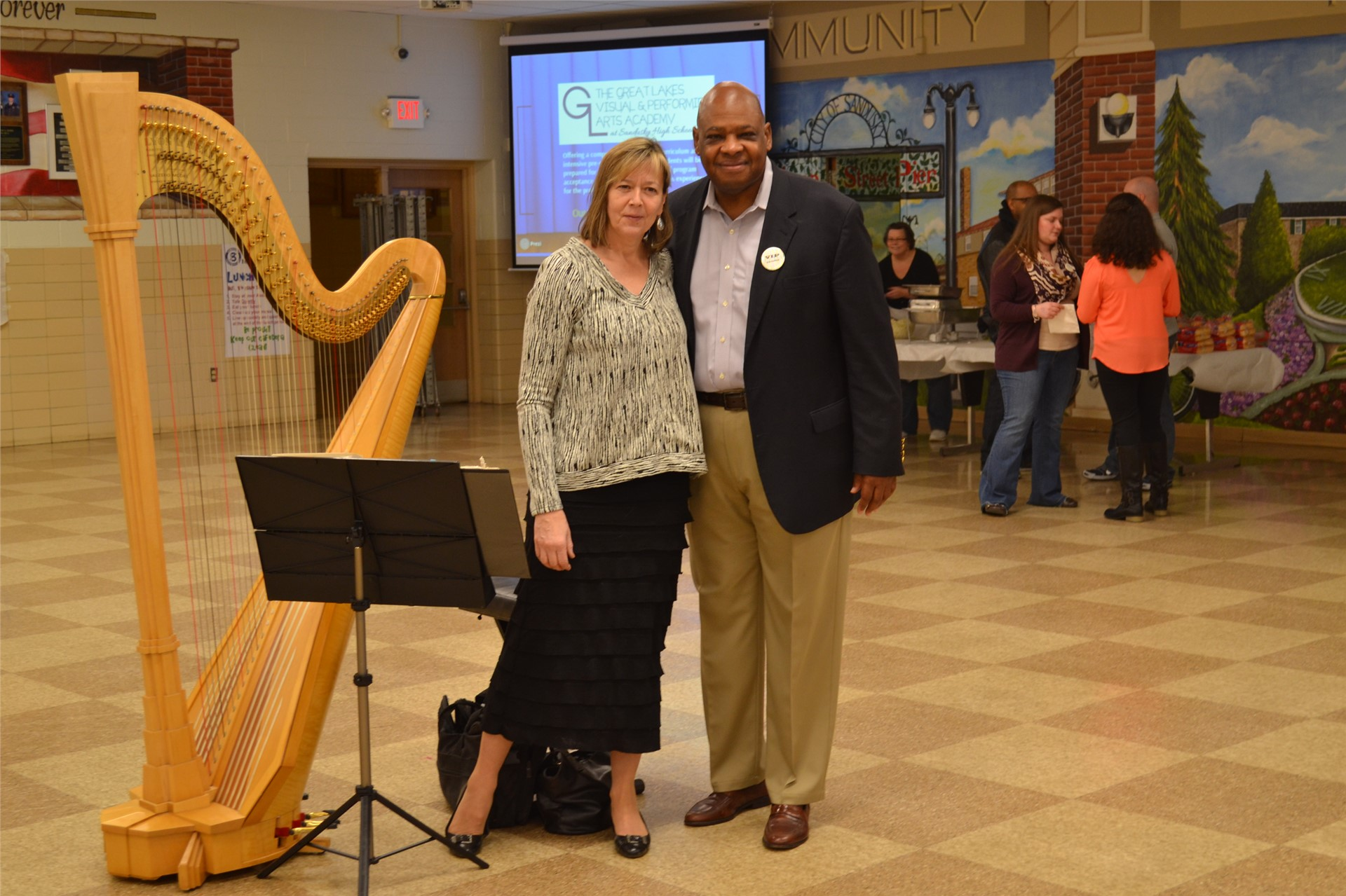 Photo of Dr. Sanders and a harpist
