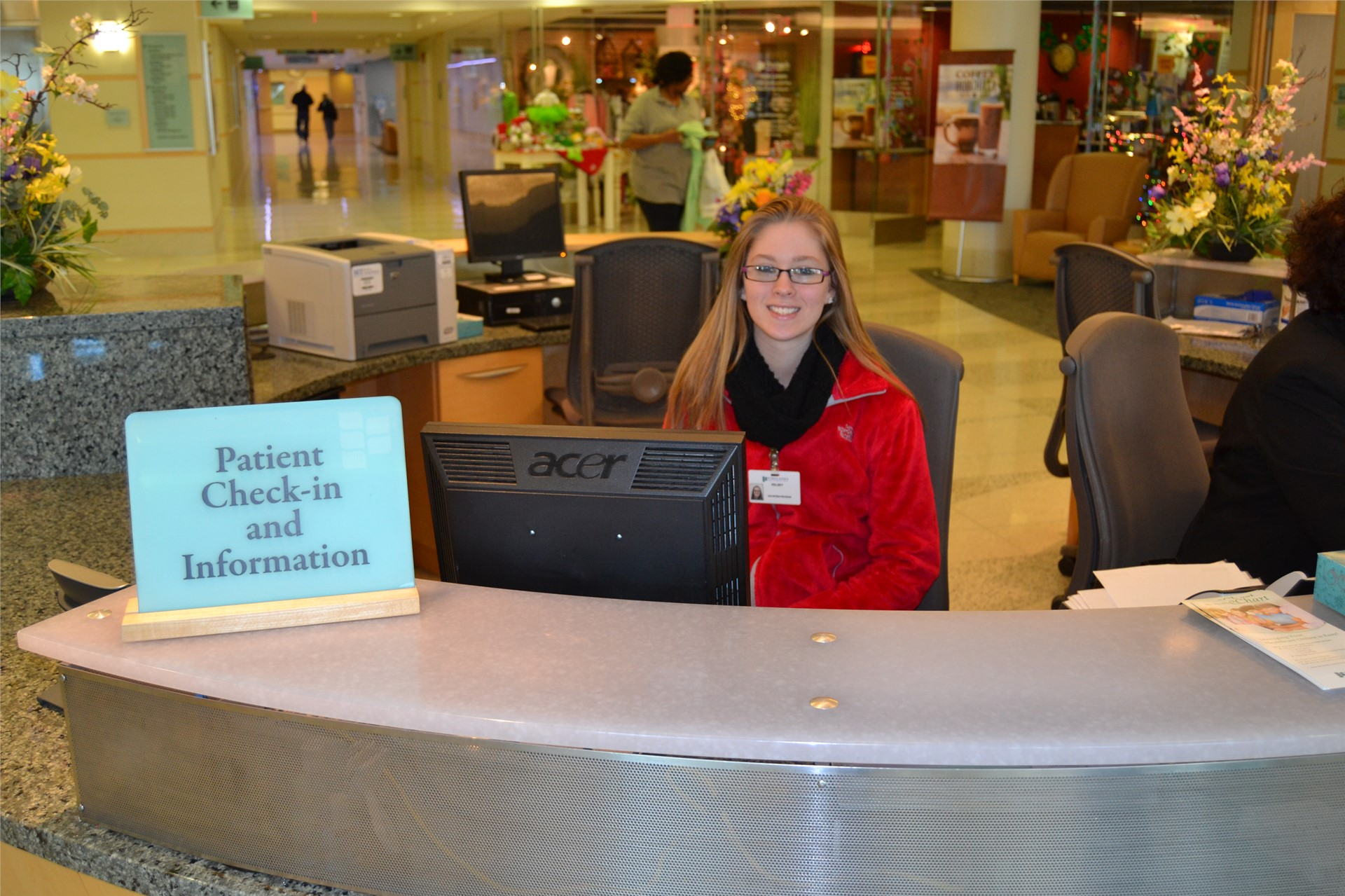 Student interning at reception desk