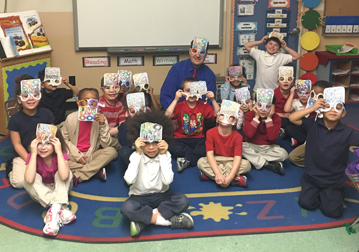 Students in Mrs. Carr's Kindergarten class celebrates 100 days smarter with Mr. Kozak