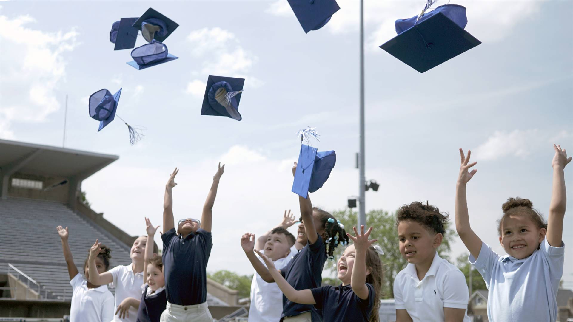 Preschool Students Throwing Graduation Hats