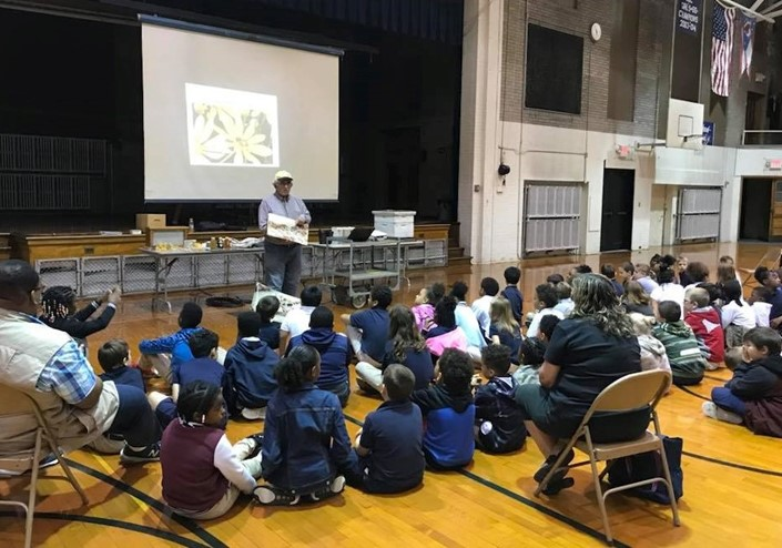 Local Beekeeper, John Schick, shares his knowledge about Honey Bees and Pollination with district 3rd graders!