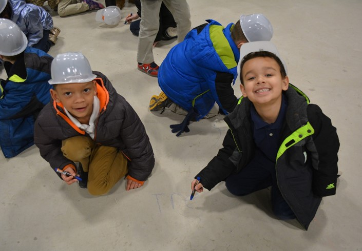 1st Graders Sign Floor at Sandusky Primary
