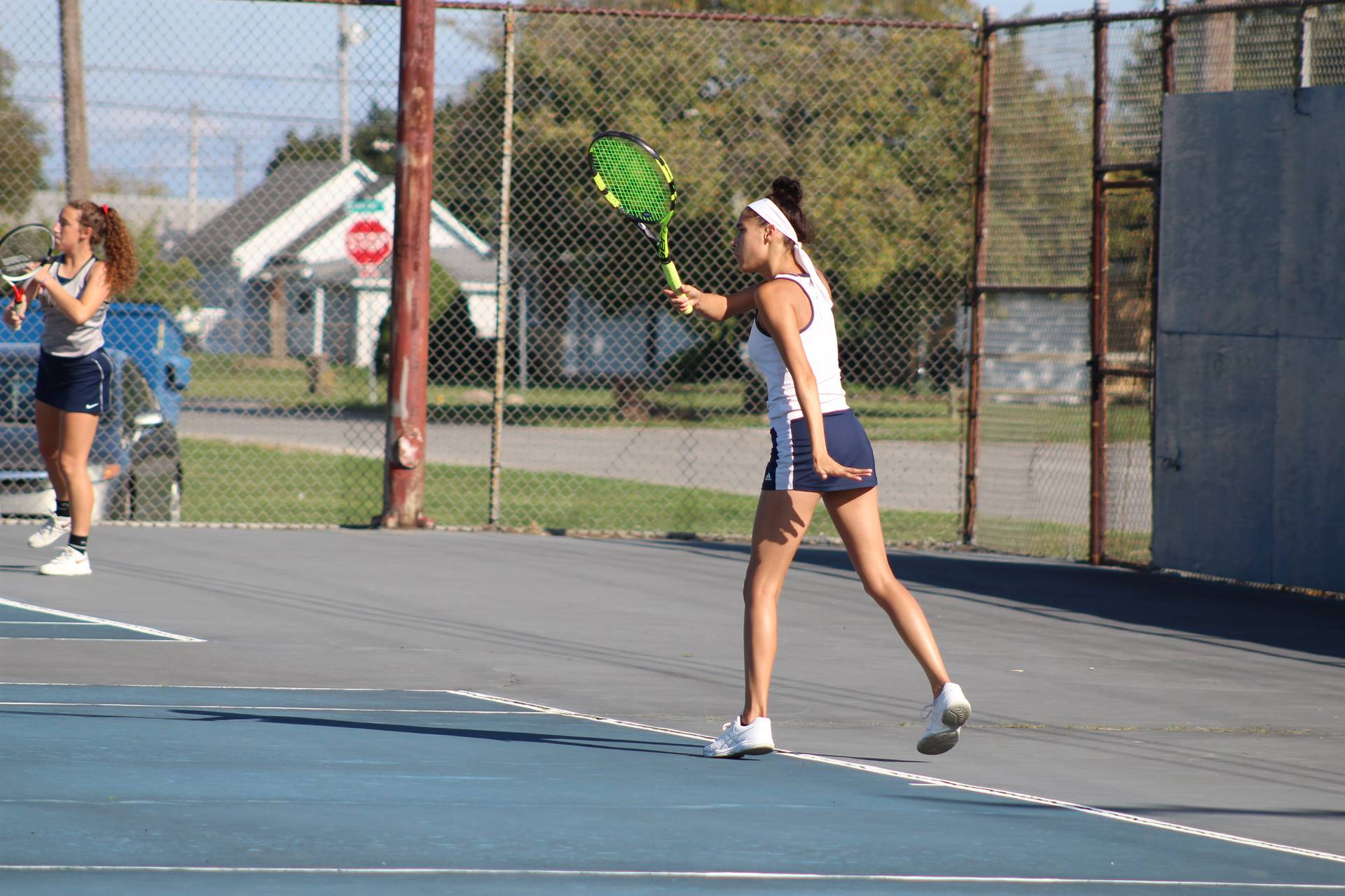 Student Playing Tennis